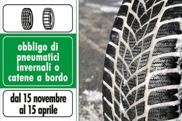 gomma invernale con accanto cartello di obbligo pneumatici invernali o vatene a bordo dal 15/11/2016 al 15/04/2017